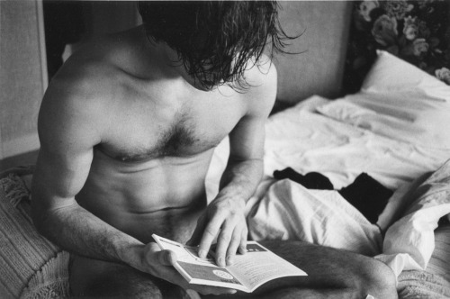 Hervé Guibert reading on bed